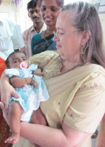 Bonnie holding baby Louis named in India