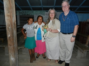 "I am 5' 8.5"" tall; Bonnie is 5' 2"" tall, but we sometimes feel like giants abroad, here pictured with dear brethren among the  Amerindians at Paramakatoi, Guyana, South America."