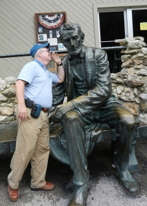 I whispered some advice into Abe's ear.