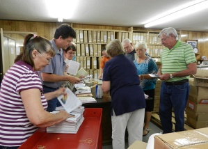 volunteers vs. 25,000 books
