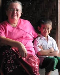 Bonnie with boy in his home (Mandalay, Burma 2012)
