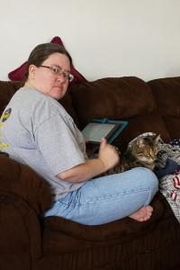 Rebecca, her Nook book & Raymond's cat